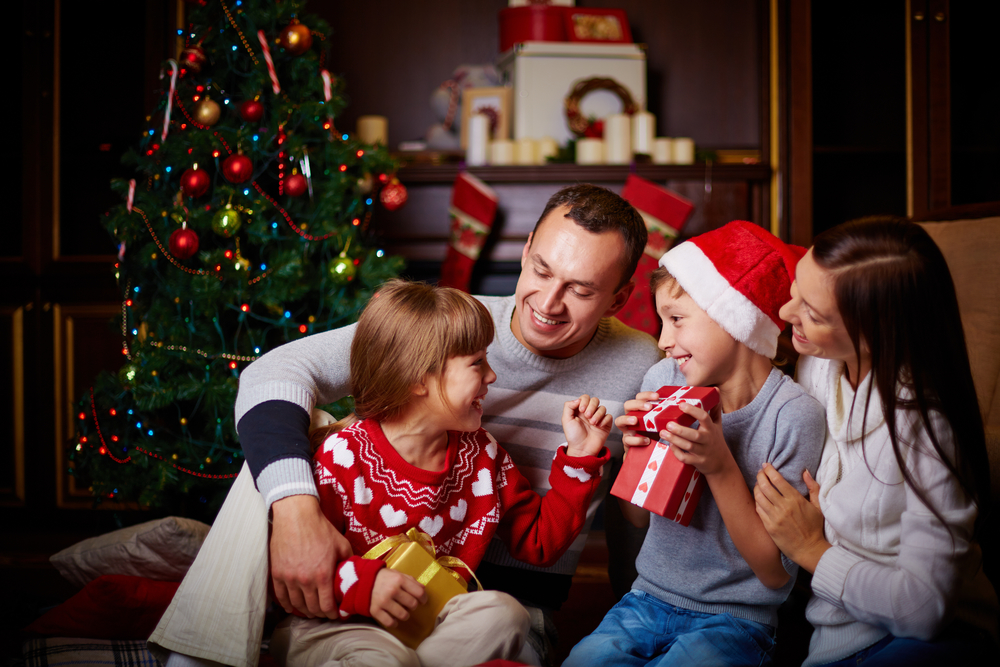 Joyful family having fun on Christmas evening at home